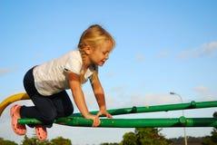 Kind auf Spielplatz Stockbilder