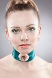 Kind beautiful woman with unusual necklace Stock Photo