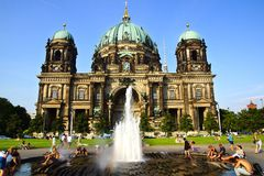 Kind on the Berlin Cathedral and fountain. Royalty Free Stock Photo