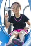 Kind bij Speelplaats Stock Foto's