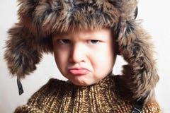 Kind in bont hat.fashion.winter style.little boy.children Royalty-vrije Stock Afbeelding