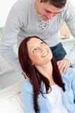 Kind boyfriend massaging his girlfriend's neck Stock Image