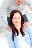 Kind boyfriend massaging his girlfriend shoulders Stock Images
