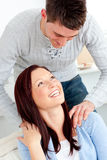 Kind boyfriend massaging his girlfriend shoulders Royalty Free Stock Photo
