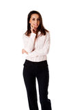 Kind business woman. Beautiful kind smiling successful Caucasian Hispanic entrepreneur business woman standing, wearing dark blue pants and pink shirt with hand stock image