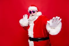 Kind cheerful positive stylish fooling around aged Santa in trad stock images