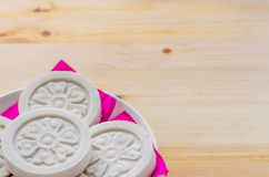 Kind of Chinese pancake made of rice-flour on wooden background. Stock Photo
