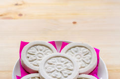 Kind of Chinese pancake made of rice-flour on wooden background. Royalty Free Stock Photo