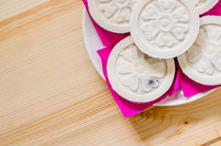 Kind of Chinese pancake made of rice-flour on wooden background. Royalty Free Stock Images