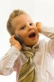 Kind, das über Mobiltelefon spricht Lizenzfreie Stockbilder
