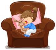 Kind, das auf Lehnsessel schläft Stockfoto
