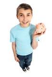 Kind, das einen Geldkasten anhält stockfotografie