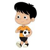 Kind, das geht, Fußball zu spielen Stockfoto