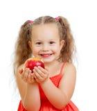 Kind, das gesunden Nahrungsmittelapfel isst Lizenzfreies Stockfoto