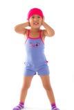 Kind, das ihre Ohren schließt Lizenzfreies Stockfoto