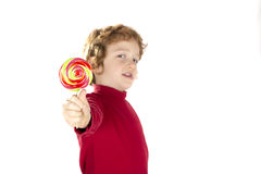 Kind, das Lutschersüßigkeit hält Stockfoto