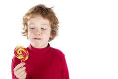 Kind, das Lutschersüßigkeit isst Lizenzfreies Stockbild