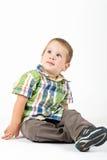Kind, das oben schaut Lizenzfreie Stockfotografie