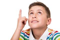 Kind, das oben zeigt Stockbild