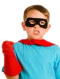 Kind, das vortäuscht, ein Superheld zu sein stockbilder