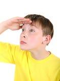 Kind, das weg schaut Lizenzfreie Stockbilder