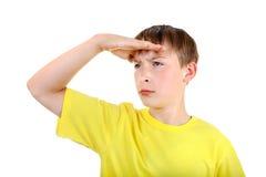 Kind, das weg schaut Stockbild