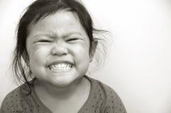 Kind, das Zähne zeigt Lizenzfreie Stockfotografie