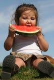 Kind dat Watermeloen eet stock foto