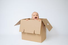 Kind in de doos Royalty-vrije Stock Foto