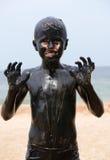 Kind in de modder royalty-vrije stock fotografie
