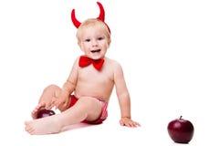 Kind in der roten Klage des verlockenden Teufels Lizenzfreies Stockbild