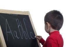 Kind an der Tafel Stockfotos