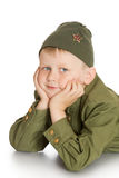 Kind in der Uniform lizenzfreie stockfotografie