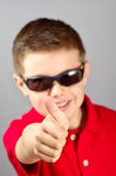 Kind die duim 2 opheffen Stock Foto