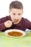 Kind die 11 eten Stock Foto's