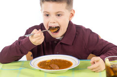 Kind die 14 eten Royalty-vrije Stock Afbeeldingen