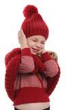 Kind die haar oren sluiten Stock Afbeeldingen