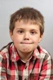 Kind die lelijke gezichten 3 maken Royalty-vrije Stock Afbeeldingen