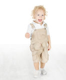 Kind die zich op witte vloer bevinden Royalty-vrije Stock Afbeelding
