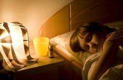 Kind durch Grippe Stockfoto