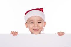 Kind in een hoed van Kerstmis met spatie stock foto's