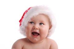 Kind in einer Weihnachtsschutzkappe, die beiseite 2 schaut stockbild