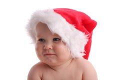 Kind in einer Weihnachtsschutzkappe, die beiseite schaut lizenzfreies stockbild