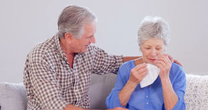 Kind elderly husband comforting his wife stock video footage