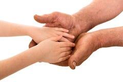 Kind en oude mensenhanden Stock Foto