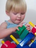 Kind en speelgoed Royalty-vrije Stock Afbeeldingen