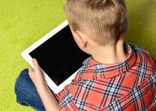 Kind en tablet Royalty-vrije Stock Afbeelding