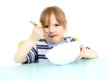 Kind essen Suppe Stockbild