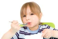 Kind essen Suppe Stockfotos