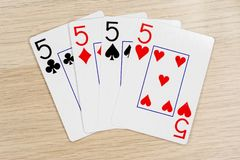 4 of a kind fives 5 - casino playing poker cards stock photo